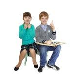 Garçon et fille avec le livre Photos stock