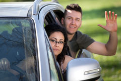 Garçon et fille dans la voiture Photos stock