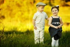 Garçon et fille heureux Photographie stock