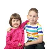 Garçon et fille sur le gris Images libres de droits