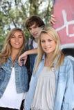 Garçon et 2 filles Images stock