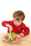 Garçon et légumes photo stock