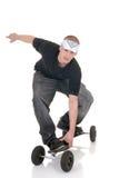 Garçon et sa planche à roulettes Photographie stock libre de droits