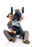 Garçon et sa planche à roulettes Photos stock