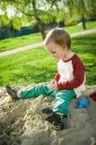 Garçon et sable Photographie stock libre de droits