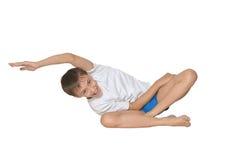 Garçon faisant des exercices Images stock