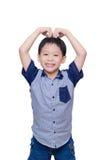 Garçon faisant le signe d'amour Photographie stock