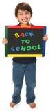 Garçon heureux avec de nouveau à l'école image libre de droits