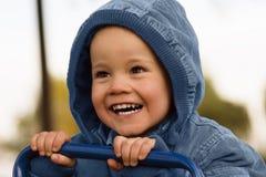 Garçon heureux riant Photographie stock libre de droits