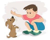Garçon jouant avec un chien Images stock