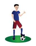 Garçon jouant le football Photographie stock