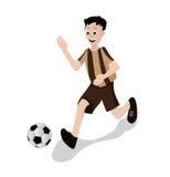 Garçon jouant le football Photos libres de droits