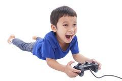 Garçon jouant le jeu vidéo Images libres de droits