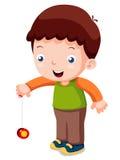 Garçon jouant le yo-yo Photo libre de droits
