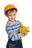 Garçon joyeux dans le casque de construction photographie stock