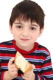 Garçon mangeant du pain grillé Images libres de droits