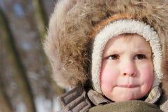 Garçon mignon dans le snowsuit Images libres de droits