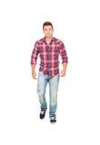 Garçon occasionnel avec la marche de chemise de plaid Image stock