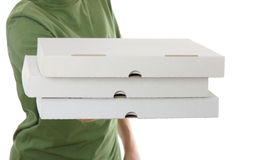 Garçon portant la boîte à pizza Image stock