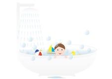 Garçon prenant un bain Photographie stock libre de droits