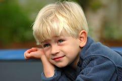 Garçon rêveur Photo stock