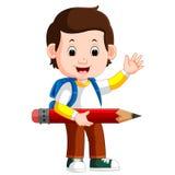 Garçon retenant le grand crayon illustration stock