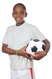 Garçon retenant une bille de football Photographie stock
