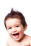 Garçon riant mignon heureux d'enfant en bas âge Image libre de droits