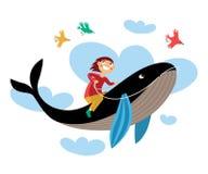 Garçon s'asseyant à cheval sur une baleine Photos stock