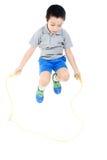 Garçon sautant de corde Photo libre de droits