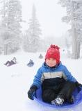 garçon sledding Photographie stock libre de droits