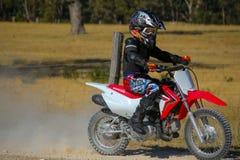 Garçon sur la motocyclette Photo stock