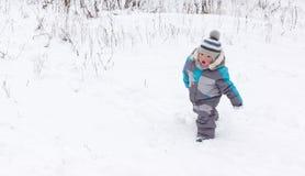 Garçon sur la neige Photographie stock