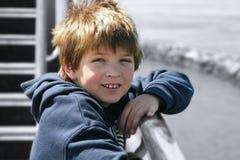 Garçon sur le bateau Photos libres de droits