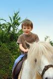 Garçon sur le cheval Photo stock