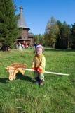 Garçon sur le cheval en bois Image libre de droits