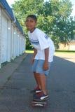 Garçon sur le panneau de patin Images libres de droits