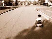Garçon sur le tricycle photos libres de droits