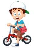 Garçon sur une bicyclette Photo libre de droits