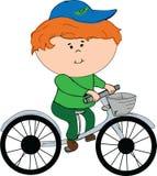 Garçon sur une bicyclette Photos libres de droits