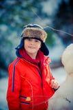 Garçon sur une neige Photographie stock libre de droits