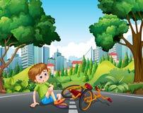 Garçon tombant le vélo sur la rue illustration stock