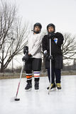 Garçons de joueur de hockey sur glace. Image libre de droits