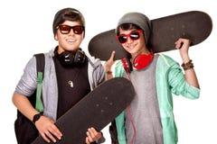 Garçons heureux avec des planches à roulettes Image stock