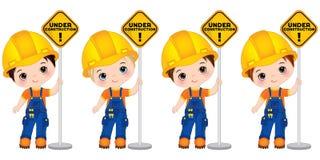 Garçons mignons de vecteur petits tenant le signe - en construction Petits constructeurs de vecteur Images stock