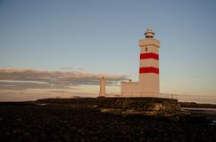 Sunset and old lighthouse in Garður Iceland, August 2018 stock image