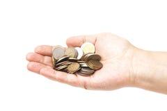 Garść monety w palmowej ręce Zdjęcia Royalty Free