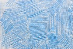 Garabatos azules del creyón en la textura de papel del fondo imágenes de archivo libres de regalías