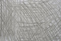 Garabatos grises del creyón en la textura de papel del fondo fotos de archivo libres de regalías