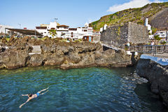 Garachico village and Natural pools in Tenerife Island. Garachico, Tenerife, Spain, June 22, 2015. Garachico village and natural pools made with volcanic debris Royalty Free Stock Image